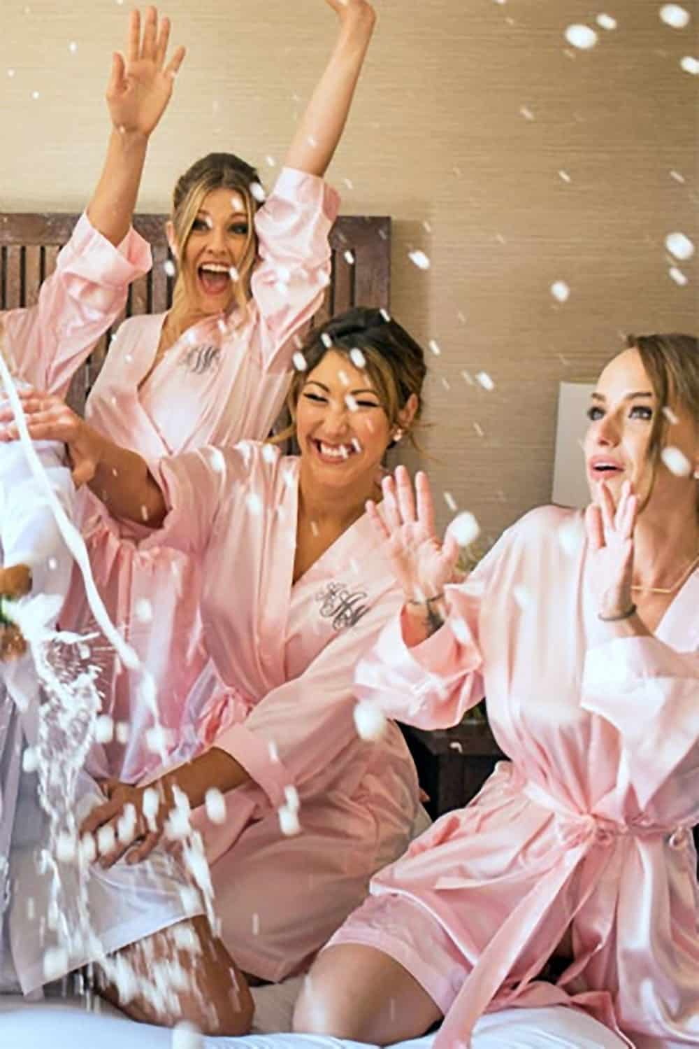 These silky satin bridesmaids and bridal robes are ideal for a Summer or warm-weather wedding. Something for the bridal party while getting ready, plus they'll use them later on, too. Allison sells them in blush pink, black, navy blue, and 10 other colors. Learn more or buy in the My Online Wedding Help Products Section