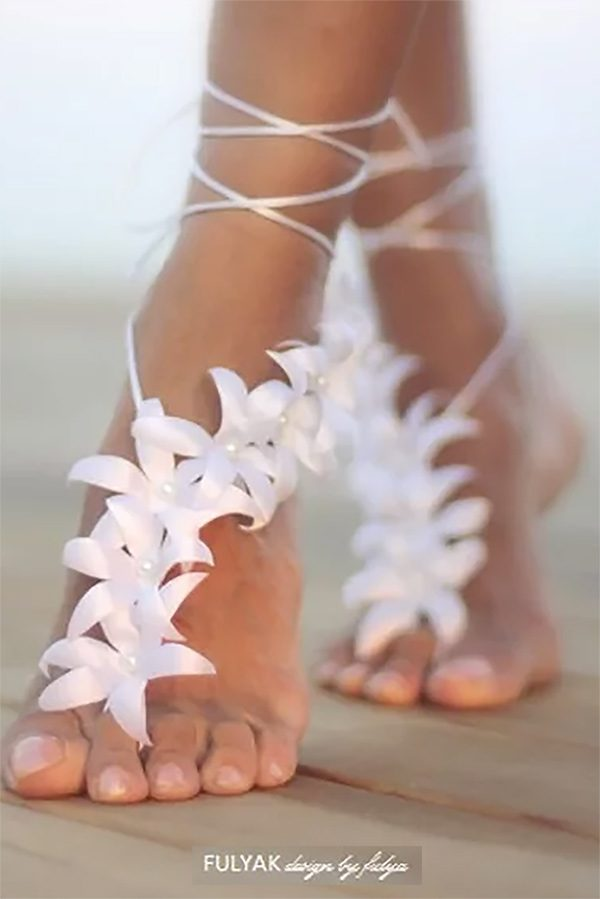 These barefoot wedding sandals would look so good at the tropical wedding, with the flowers. On the brides and bridesmaids. Take a look at them, the fourth or fifth buy listing on the page. #TropicalWedding #BarefootSandals #MyOnlineWeddingHelp #BeachWedding