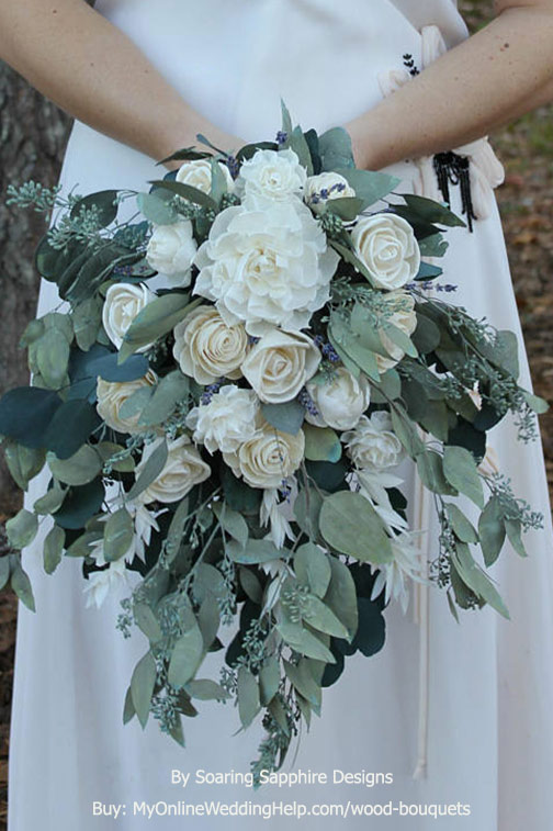 This unique sola wood flower wedding bouquet features a cascade of greenery. The seeded eucalyptus is preserved. It's so beautiful and will last for decades! Amber made this one in shades of white, but you can get it in any color you'd like. Take a look and buy through the first or second listing on the page. #WoodBouquet #MyOnlineWeddingHelp #WeddingBouquet #BridalBouquet #SolaFlowers