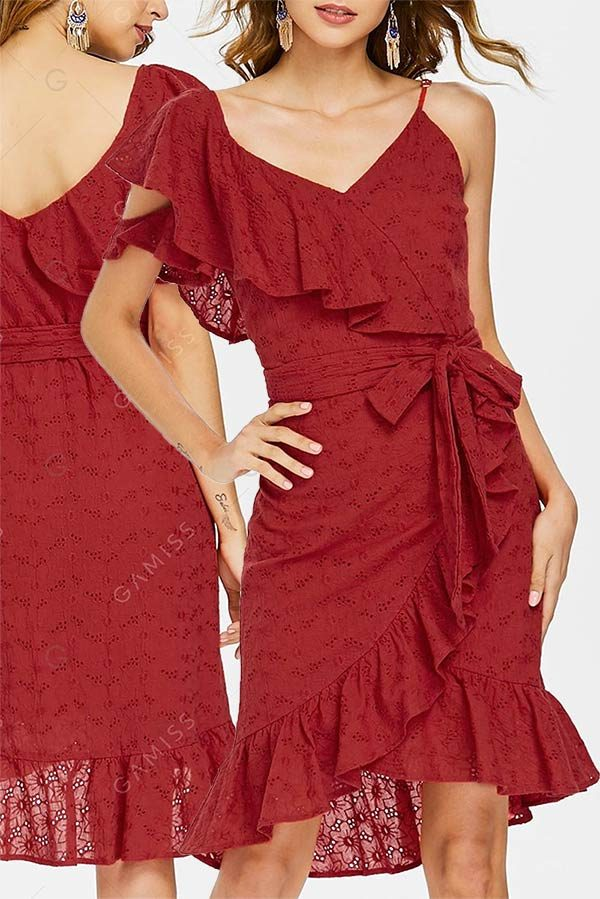 Short red wrap dress with eyelet lace and v neckline. Cute for a day wedding guest outfit. The asymmetrical shoulders and ruffled hemline make this dress unique. Tap the image and look for it as the first or second buy listing on the page. In the My Online Wedding Help products section. #SpecialOcassionDresses #WeddingGuestOutfit #MyOnlineWeddingHelp #WrapDresses #RedDresses