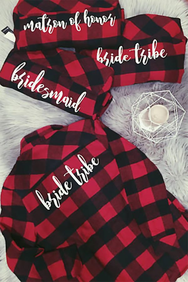 "Personalized long-sleeve wedding shirts are a great idea for bridesmaids and the bride. These plaid flannel bridesmaids shirts are also an awesome gifts idea for the maids in a Fall or Winter wedding. (Especially one with a rustic theme!) Get them like in the pic, with ""maid of honor"" or ""bridesmaid,"" OR have Katelin also add monograms on the front pockets. #BridesmaidsIdea #BrideIdea #MyOnlineWeddingHelp #BridesmaidsShirts #WeddingShirts #FallWeddingIdea #WinterWeddingIdea #BridesmaisGiftIdea"