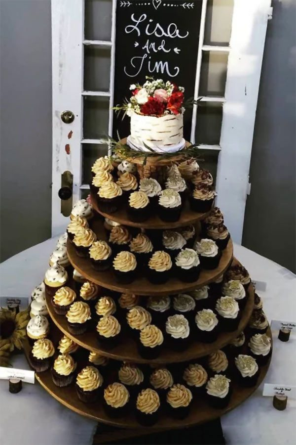 Rustic wedding cupcake display. Made from real wood, this one has bark spacers between the five tiers. Display at receptions, as part of the dessert buffet or dessert table. Holds 120 cupcakes. $165. #MyOnlineWeddingHelp #RusticWedding #CupcakeDisplay