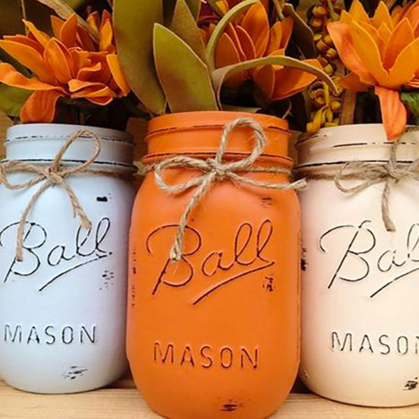 Mason jar decorations for a fall wedding. She paints, distresses, and seals them. Then ties a piece of jute string around the neck for a rustic look. Choose from 10 different autumn-friendly colors. $18.00 for a set of three. Learn more through the second buy listing on the page. In the My Online Wedding Help products section. #MyOnlineWeddingHelp #RusticDecorations #FallWedding
