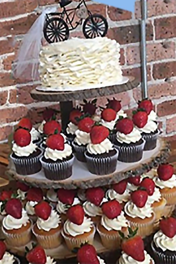 Rustic cupcake stand made from wood slices and little logs. Perfect. $79.95. Learn more or buy in the My Online Wedding Help products section. #RusticWeddings