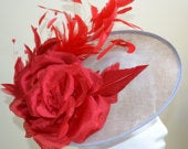 A mid grey sinamay saucer base fascinator, with beautiful red flower and feathers..