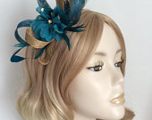 A METALLIC GOLD and TEAL Fascinator, with Feathers, chiffon spotted flower, with crystal , on a narrow silver headband