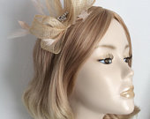 A NATURAL and NUDE FASCINATOR, Made with sinamay, feathers, Crystal embellishment , on a headband