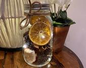 Dried orange, cinnamon, dried apple, pine cones ball mason jar with LEDs. table decoration.