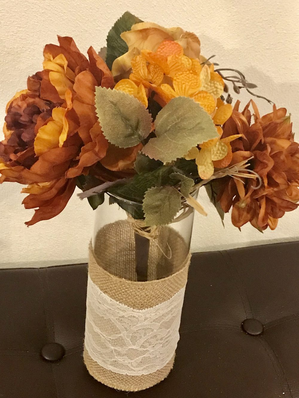 Beautiful Floral Arrangement, Vivid Flowers & Leaves in A Tall Cylinder Vase Covered Burlap Lace
