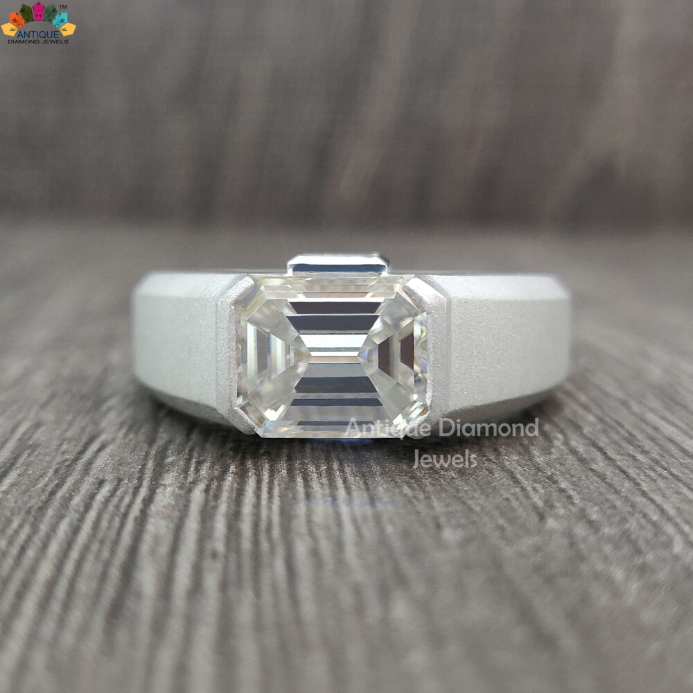 3.91 Tw Emerald Cut Colorless Moissanite Ring, Side Baguette Moissanite, Half Bezel Satin Finish Men's Engagement Ring