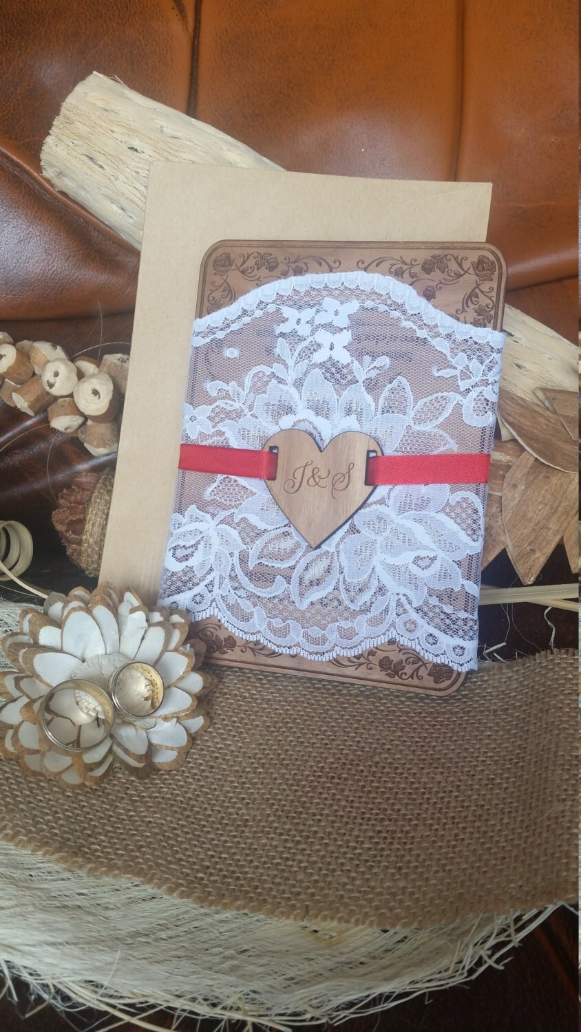 Shabby Chic Wedding Invitations Covered With White Lace, Heart Engraved Initials & Red Bow. Polished Wooden