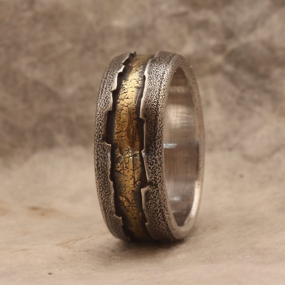 A Rustic Styled Wedding Band For Men, Handcrafted Of 18K Gold & Silver, Hammered Fused With A Hard Textural Finish Dark Patination