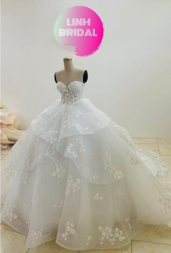 Pretty Strapless Bustier White Wedding Ball Gown With Floral Lace & Tiered Skirt
